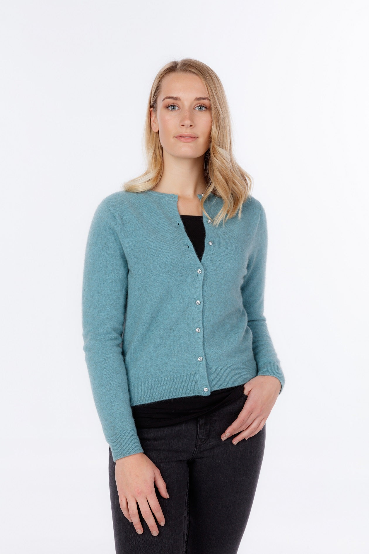 Women's crew neck, long sleeve cardigan with crystal buttons. Possum Merino Wool knit.