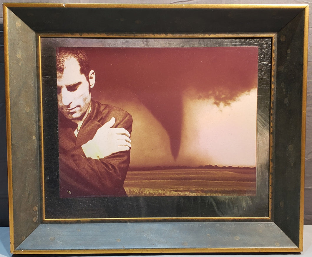 SIGNED LANCE ROGERS PAINTED PHOTOGRAPH ON BOARD OF MAN W/ TORNADO BEHIND HIM
