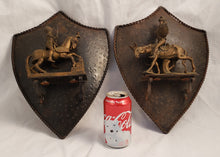 VINTAGE PAIR OF METAL KNIGHTS/DON QUIXOTE ON SHIELD WALL PLAQUES MADE IN ITALY