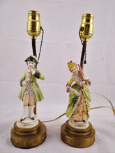 PAIR OF PORCELAIN FIGURAL TABLE LAMPS OF A VICTORIAN COUPLE MAN LADY BRASS BASE