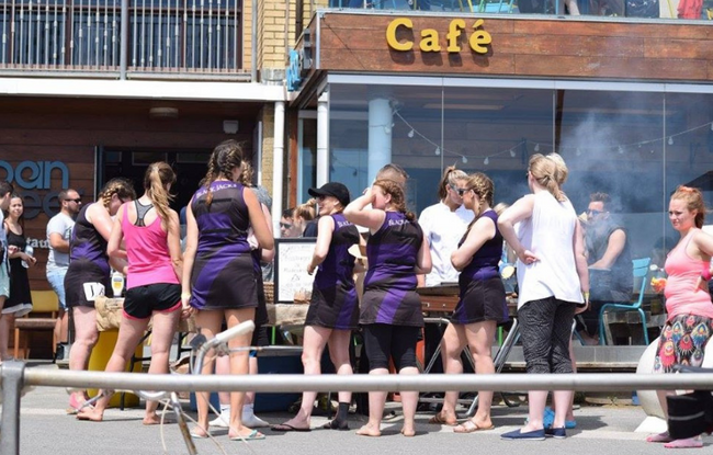 Serving drinks to the Netball Players outside the Urban Reef
