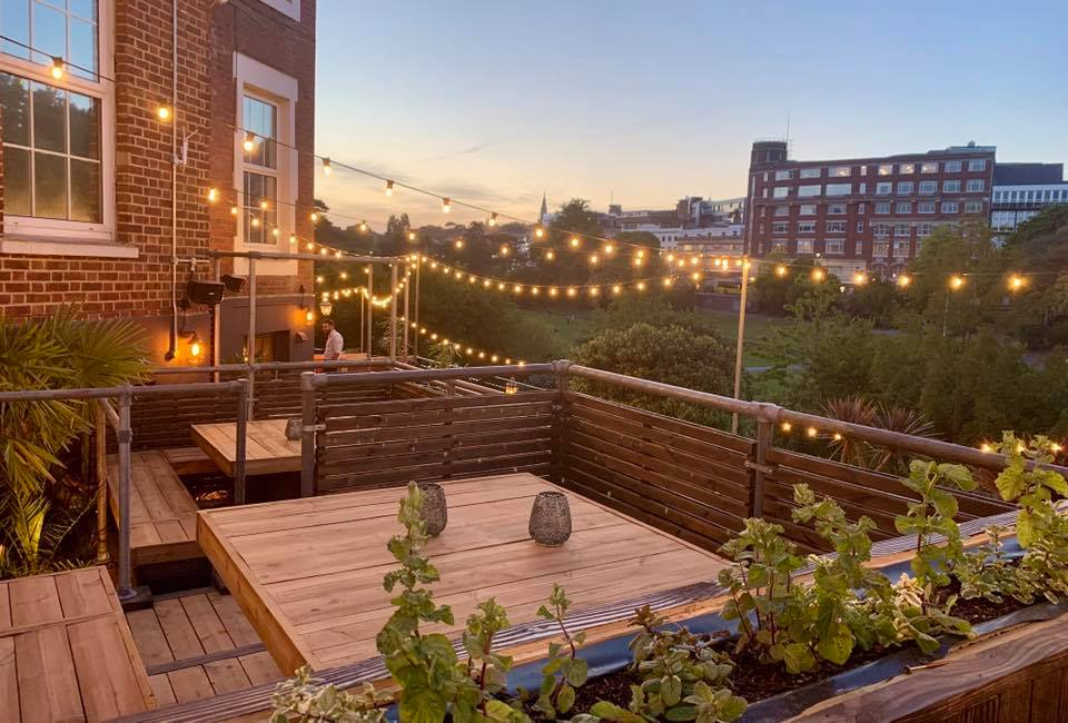 Urban Garden deck, with all the lights on overlooking the gardens