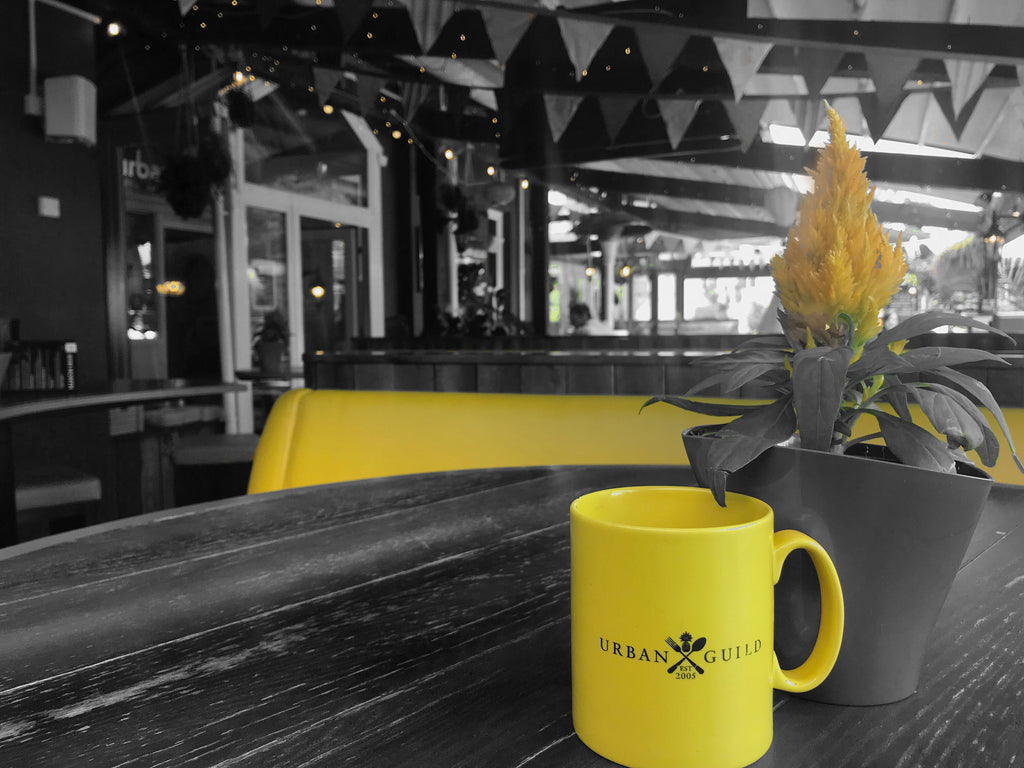 Flowers & yellow mugs at the Urban Beach Hotel