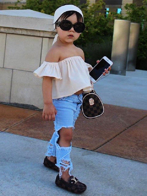 Off-Shoulder Top with Ripped Jeans and Hair Band