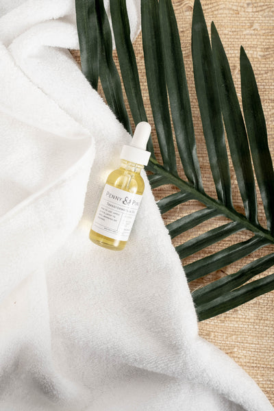 Transformation Oil on Towel and Leaf | How to Apply Facial Oils