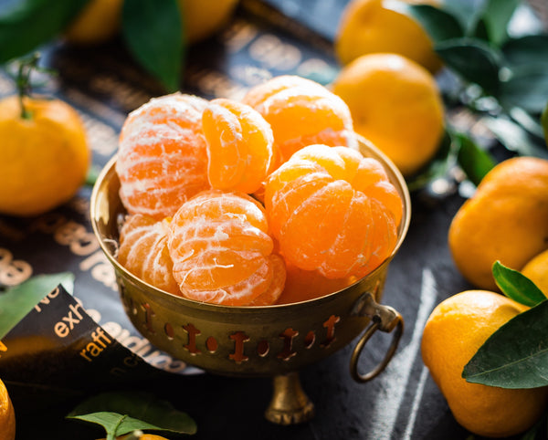 tangerines in a bowl | Best Foods for Dry Skin