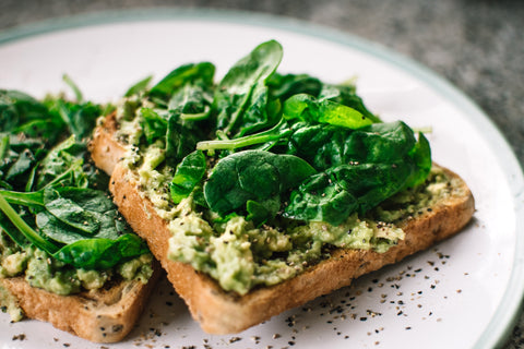avocado and spinach on toast | The Best Vitamins for Your Skin
