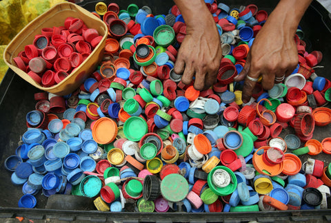 pile of bottle caps | The Benefits of Recycling