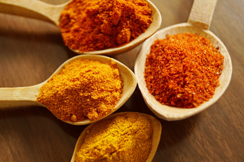 spoonfuls of turmeric and spices | Essential Oil Benefits You Didn't Know About