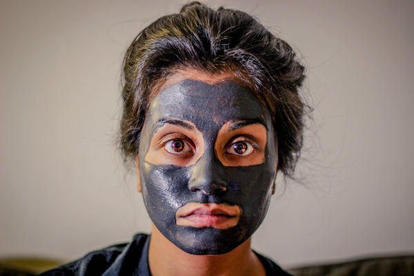 girl wearing face mask  | How to Get Rid Period Acne