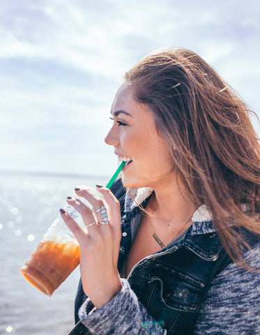 girl smiling by the ocean | The Best Vitamins for Your Skin