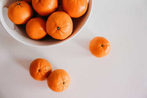 tangerines in a bowl | Essential Oil Benefits You Didn't Know About