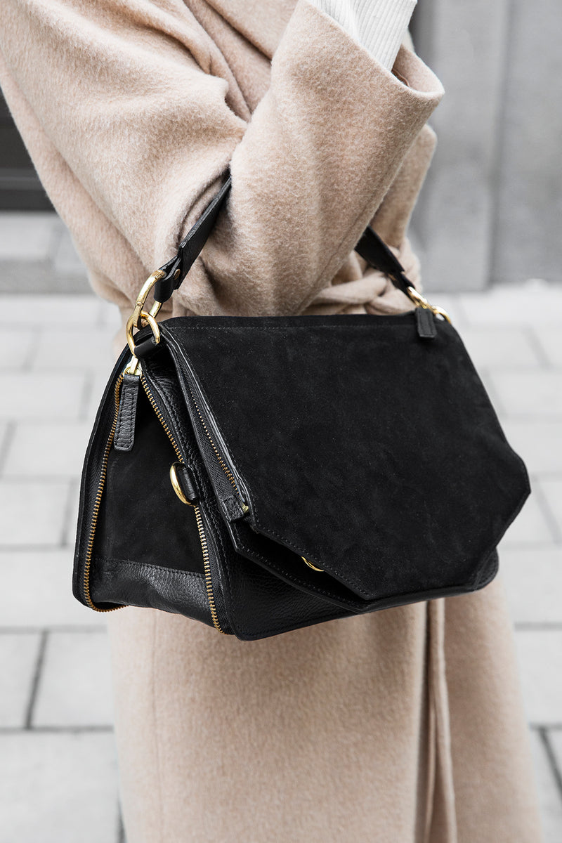 Black multifunctional handbag with gold details and a black wide strap with gold details