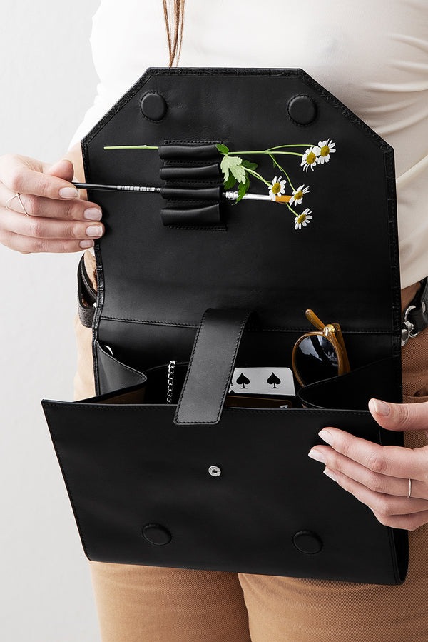 Filled compartments inside black bag