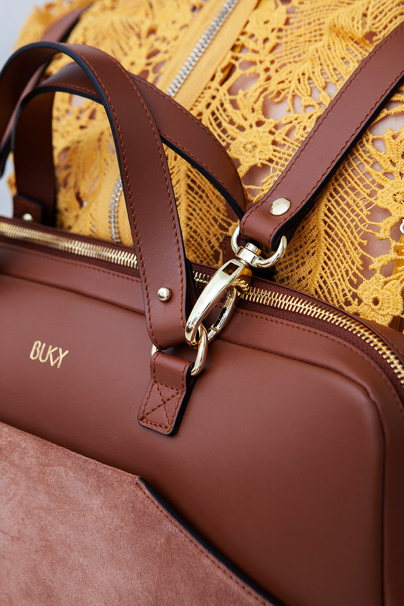 Sand-colored bag with gold details