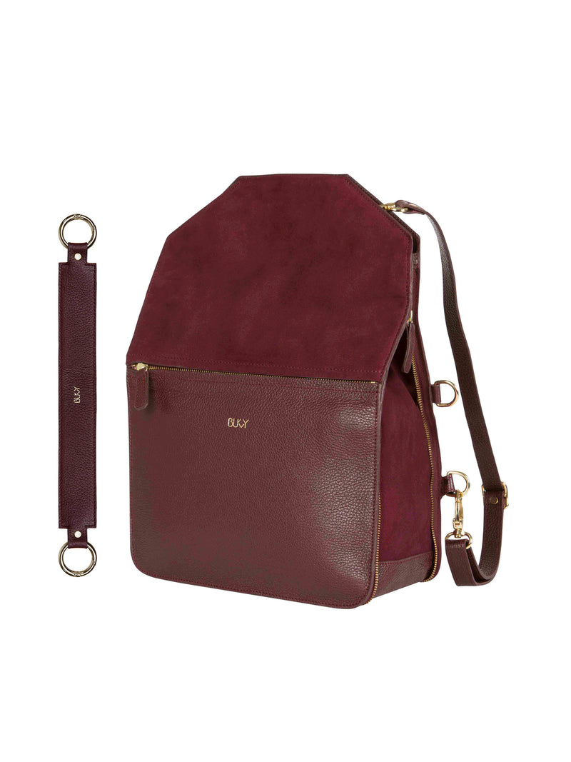 Purple multifunctional backpack with gold details and a purple wide strap with gold details