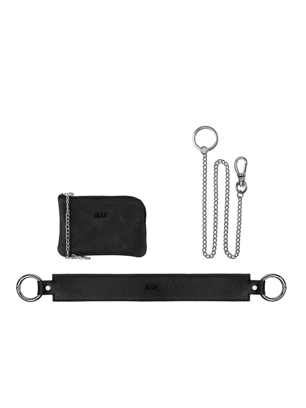 Small black wallet with silver details, silver plated key chain and a wide strap with silver details