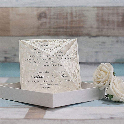 white laser cut wedding invitation
