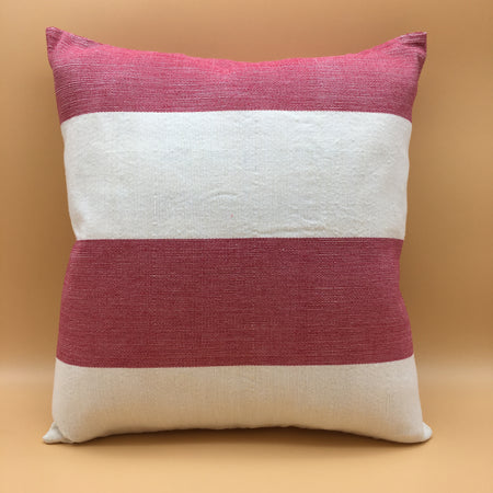 Red and cream accent pillow