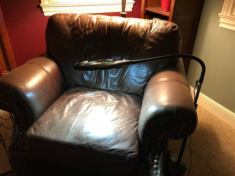 Full Page Magnifying LED Floor Lamp Shining On Reading Chair