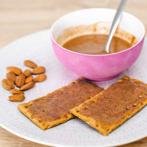 Healthy traditional Moroccan Amlou; honey, almonds and argan oil, eaten on crackers