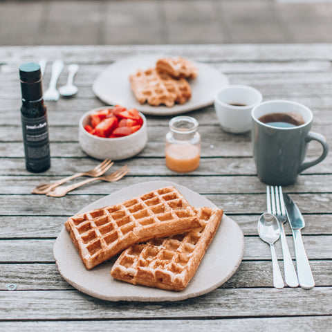gluten free, dairy free and paleo argan oil waffles on the table with fruit and coffee