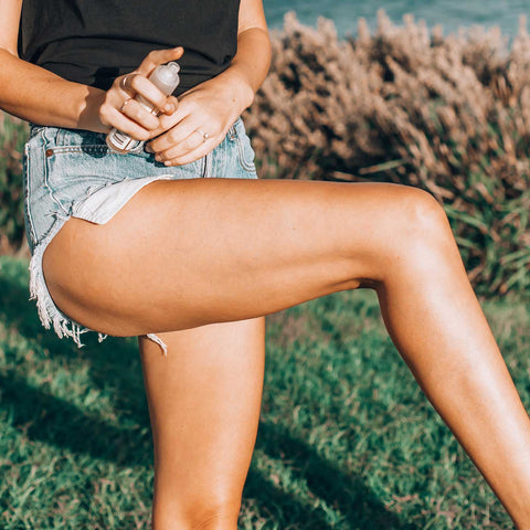 Beautiful woman's legs in Sydney, applying argan oil as part of her skincare regime