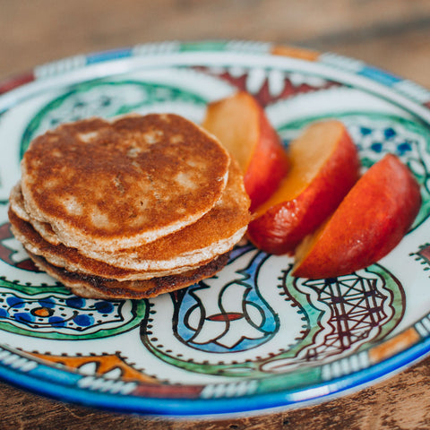 Gluten free, dairy free, paleo argan oil pancakes on a plate with fruit