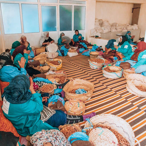Moroccan women all together in the argan oil cooperative singing and clapping, excited to be sharing the journey with youforher