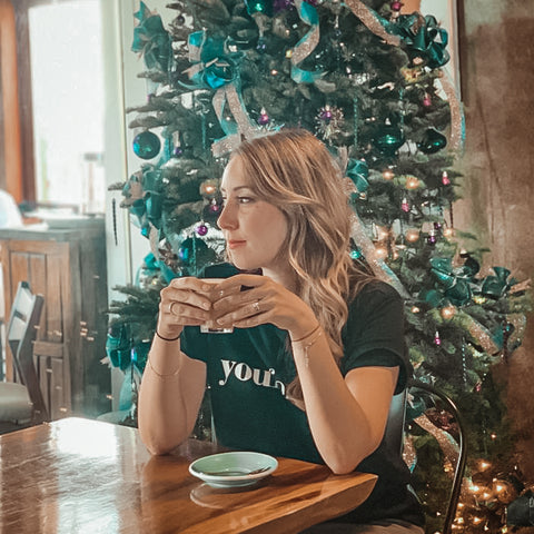 Hind, co-founder in a cafe with christmas tree