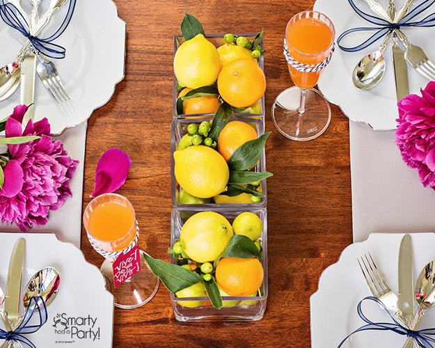 Bohemian inspired centerpiece decor! Fill vases with citrus fruits for a gorgeous summer centerpiece. | Smarty Had A Party