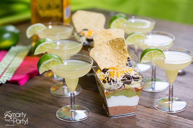 A taste of Cinco de Mayo! Mini margaritas and individual seven-layer dips. | Smarty Had A Party