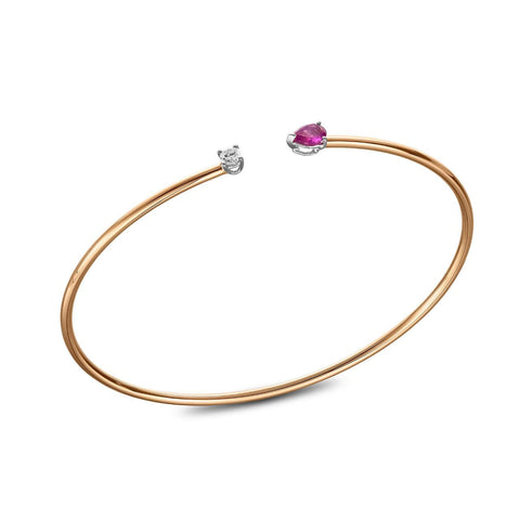 Bracelet - yellow gold bangle with 0.10carat diamond and a pear shaped rose ruby