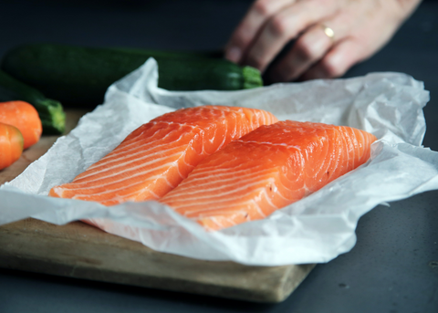 Salmon fillets on baking tray