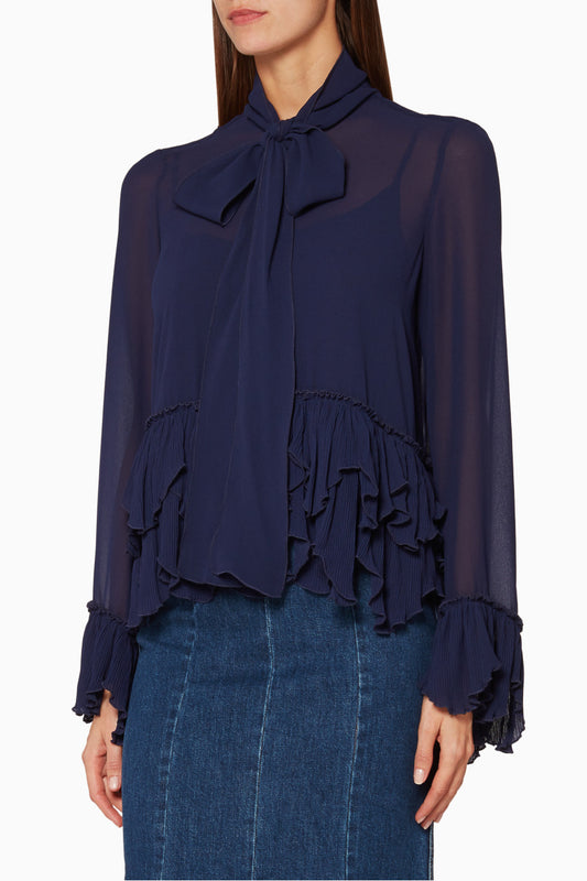 Long Sleeved Ruffle Blouse