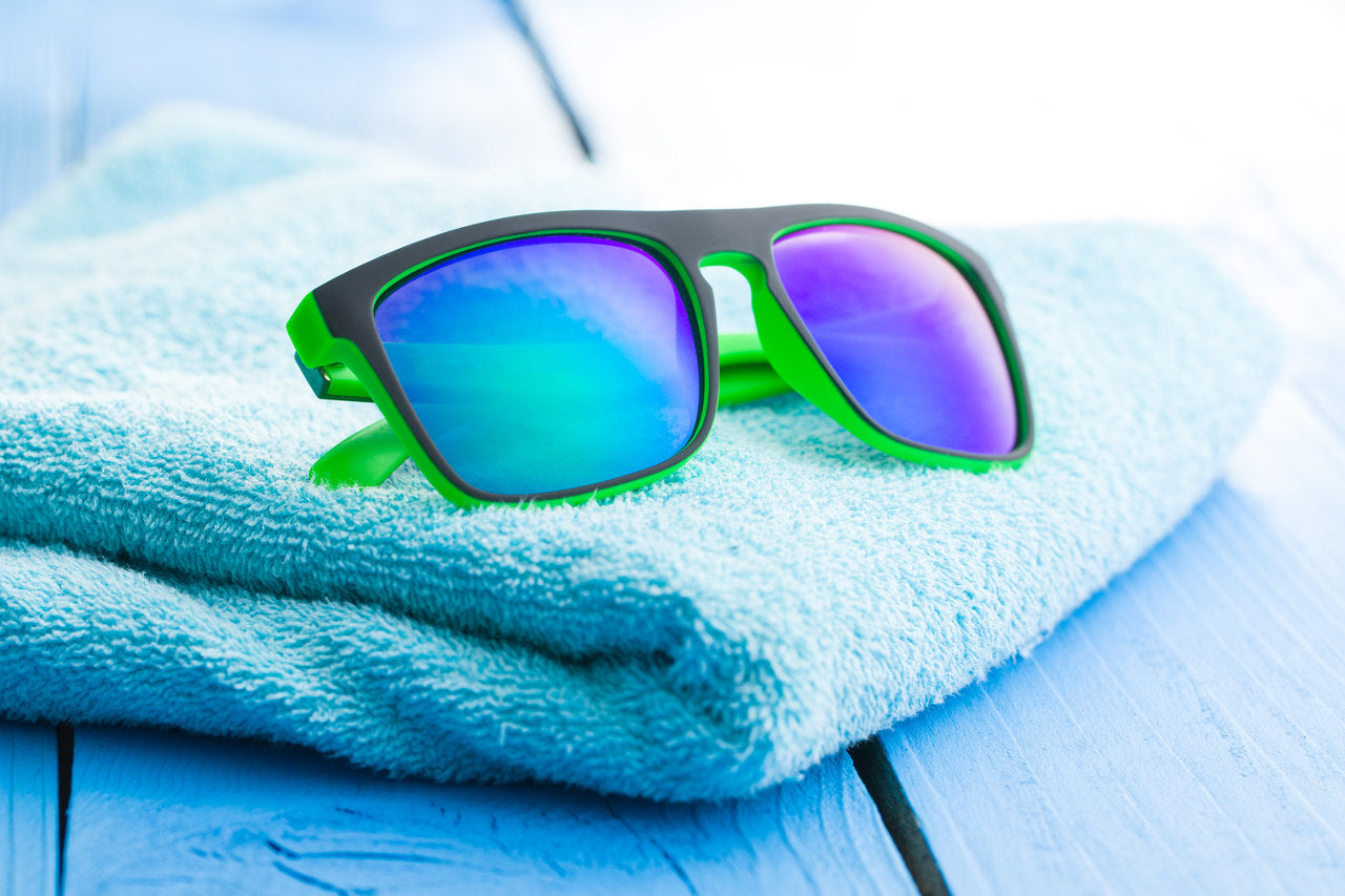 pool towel and sunglasses