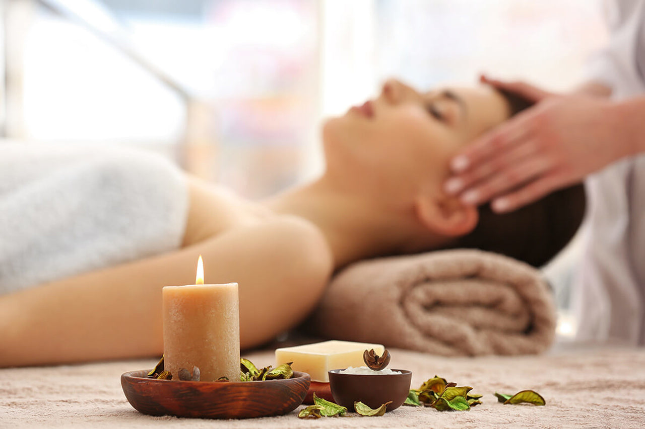 a woman laying for the aromatherapy massage