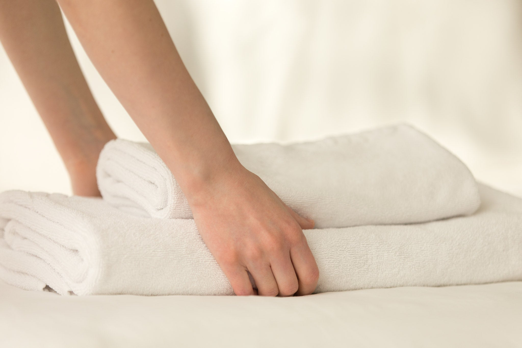 bath towels on the bed