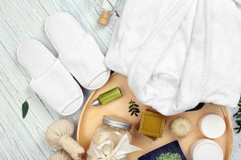spa items, white bathrobe and white slippers