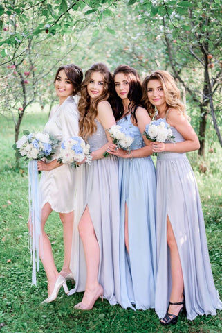 standing bride with her bridesmaids