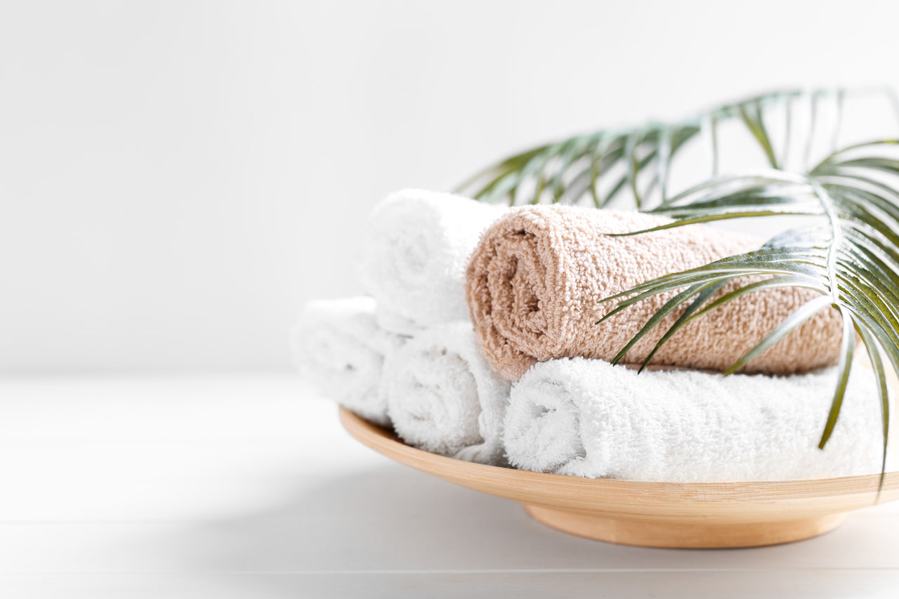 how to fold towels concept- rolled towels