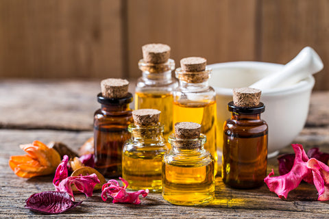 some essential oils in the glass bottles as an answer to what is aromatherapy massage question