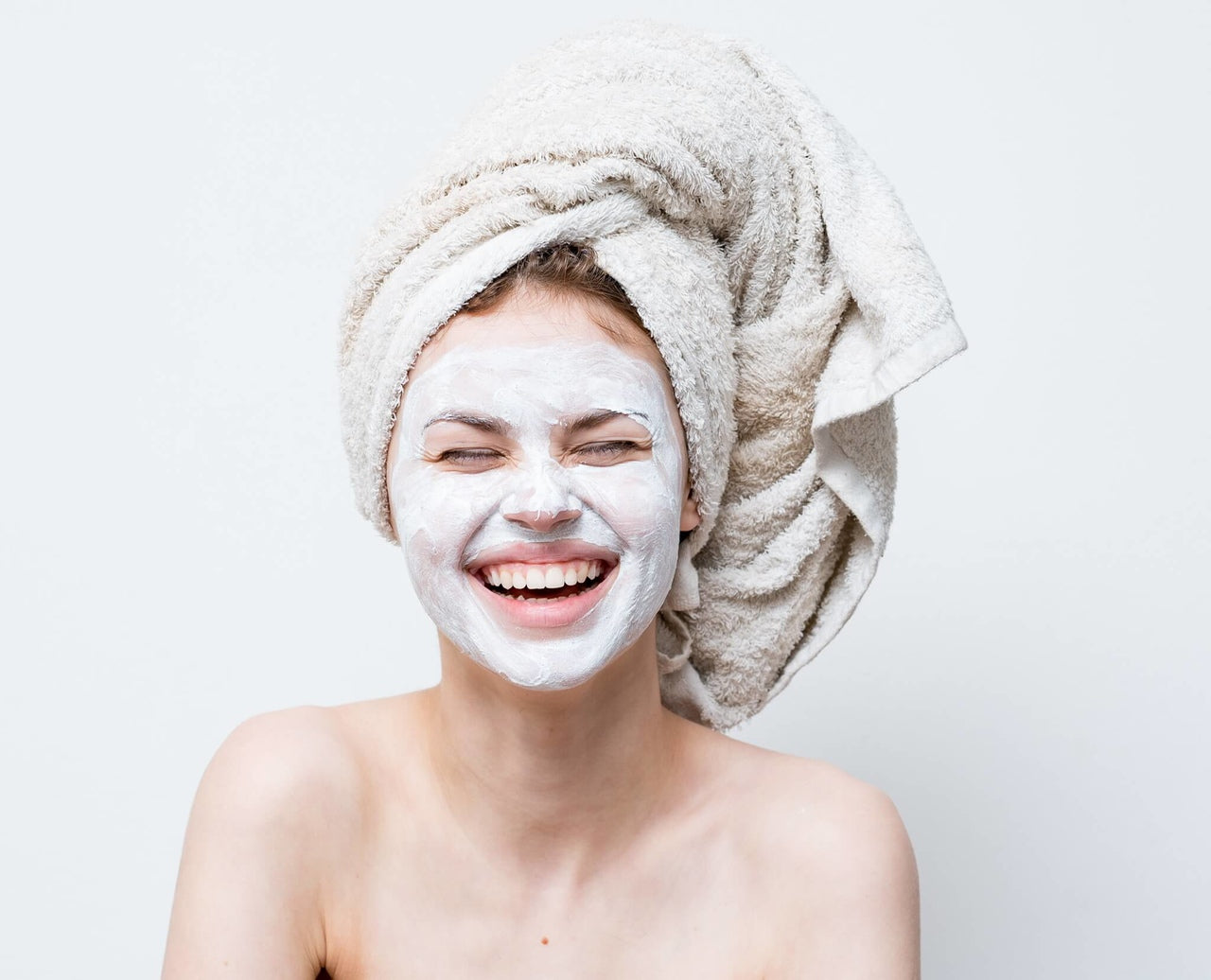 a woman with a skincare mask to have an answer to question of how to have a spa day at home