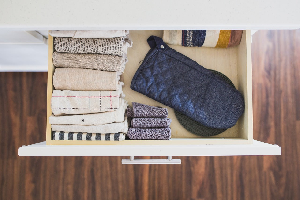 how to fold towels concept image- towels in a drawer