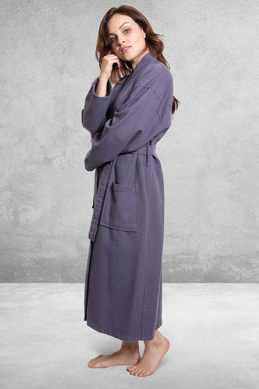 woman wearing a purple bathrobe