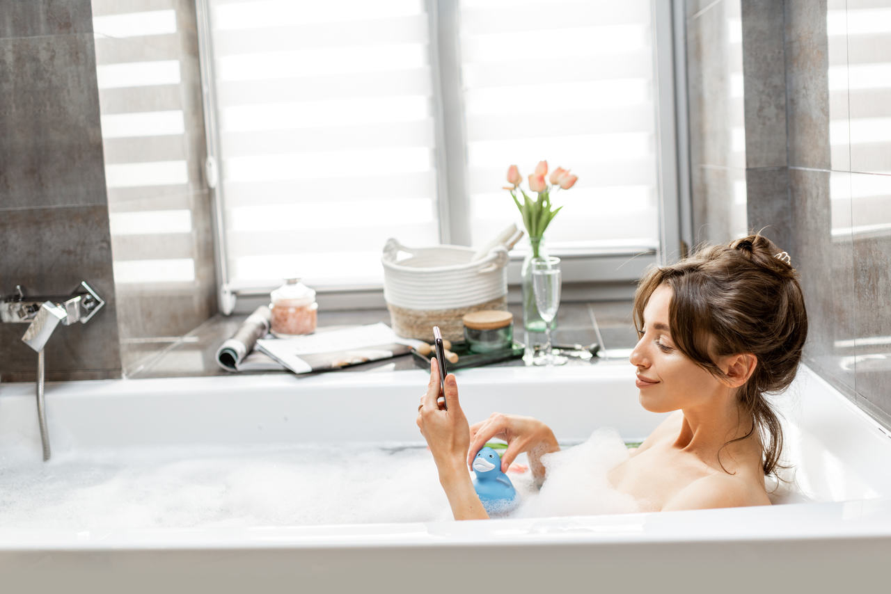 relaxed woman in a bathtub with bubbles