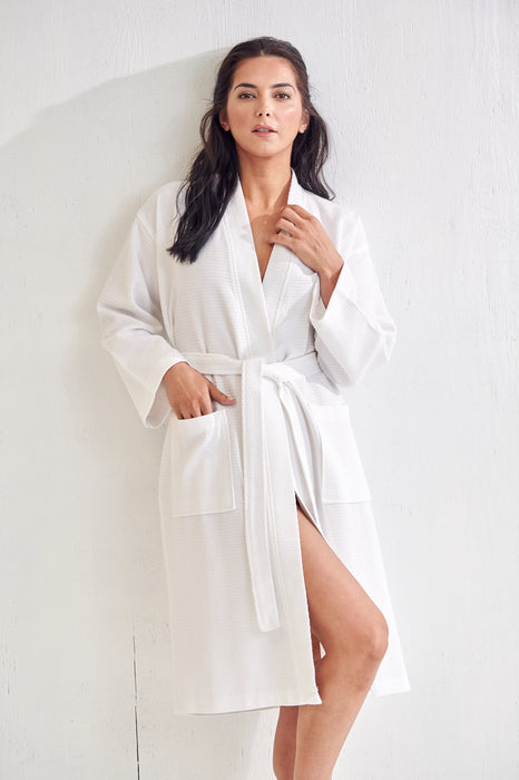 a young woman who wears a white bathrobe