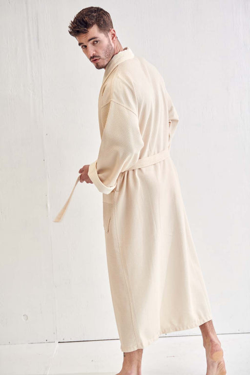 a man who wears a beige bathrobe