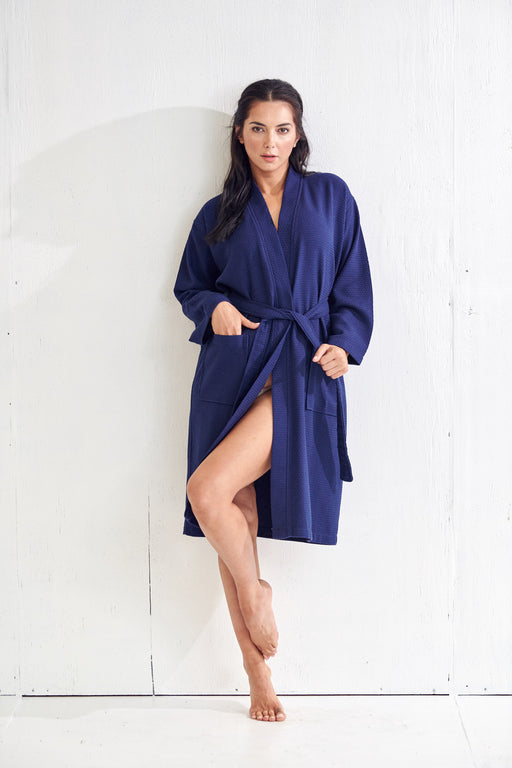 a woman who wears a blue bathrobe