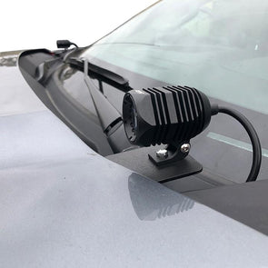 An image of an APS H1 light pod mounted on the hood of a 2019 Chevy Silverado